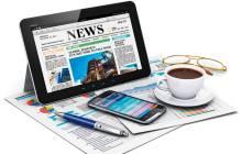 Tablet, Smartphone und Zeitung mit News