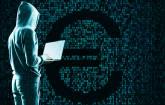 Hacker mit Eurozeichen im Hintergrund