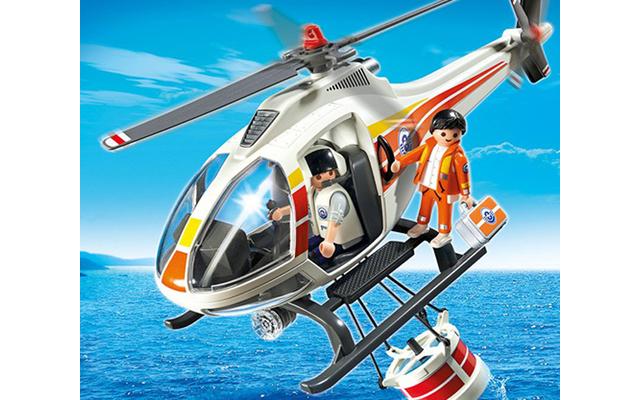 Playmobil Löschhubschrauber - Der Löschhubschrauber vereint die kindlichen Traumberufe Feuerwehrmann und Hubschrauberpilot. Die Löschtonne kann an der Unterseite des Helis befestigt und während des Fluges mit Wasser befüllt werden.