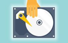 Festplatte mit Hand